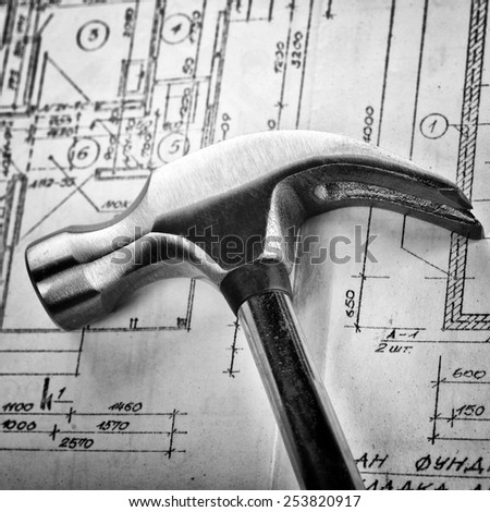 Metal hammer on drawings close up - stock photo