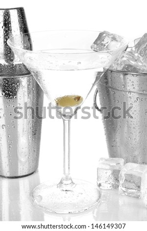 Metal ice bucket and shaker and cocktail isolated on white - stock photo