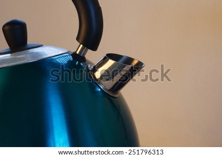 metal kettle closeup in kitchen - stock photo