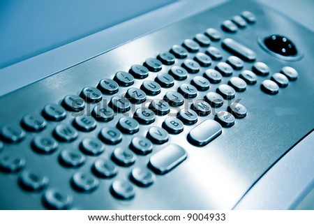 metal keyboard of a public internet terminal - stock photo
