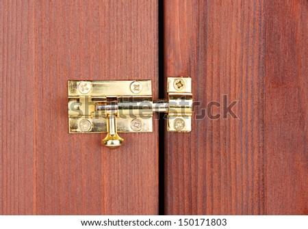 Metal latch in wooden door close-up - stock photo