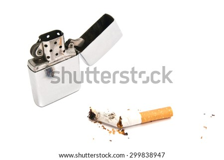 metal lighter and cigarette butt with filter on white closeup - stock photo