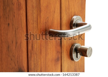 Metal lock on wooden door - stock photo