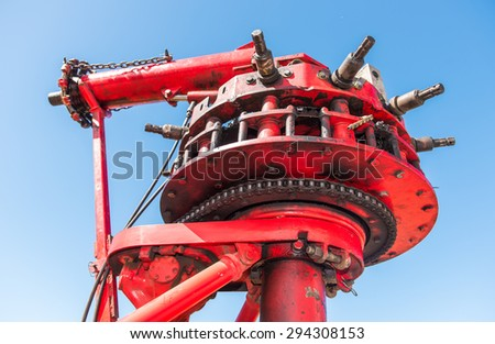 Metal machine that powers an amusement ride with chain and gears - stock photo