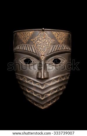 Metal mask isolated on black - stock photo