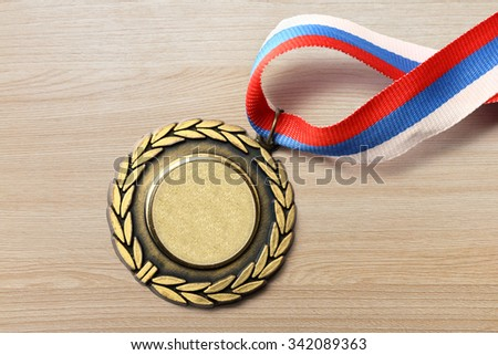 Metal medal with tricolor ribbon in closeup - stock photo