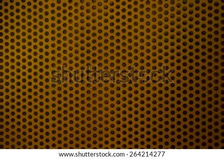 Metal Mesh with round hole tinted in Dark Red Color like Lava - stock photo
