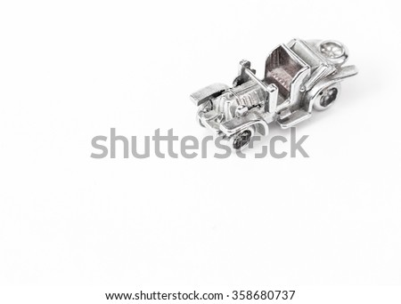 Metal model of the ancient car - stock photo
