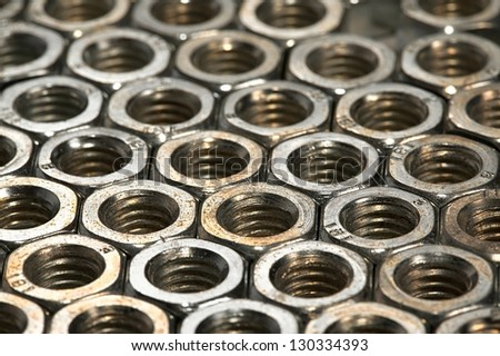 Metal nuts array - stock photo