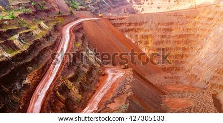 metal ore extraction quarry in sunlight in Krivyi Rih, Ukraine - stock photo