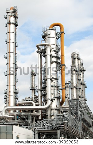 metal pipelines petrochemical industry with a nice glow of the morning sun - stock photo