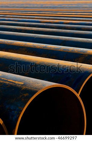 metal pipes laid out in a row for installation - stock photo