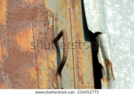 Metal plate texture with metallic detail and hole - stock photo