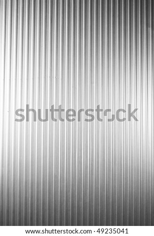 Metal plate with vertical lines - stock photo