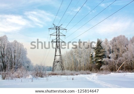 Metal poles on a winter forest glade - stock photo