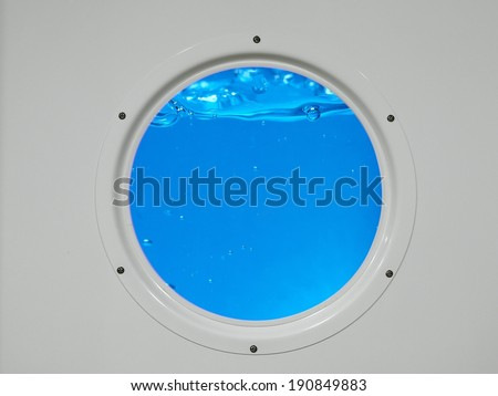 Metal porthole with water behind - stock photo