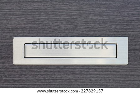 Metal post box and modern wood door - stock photo