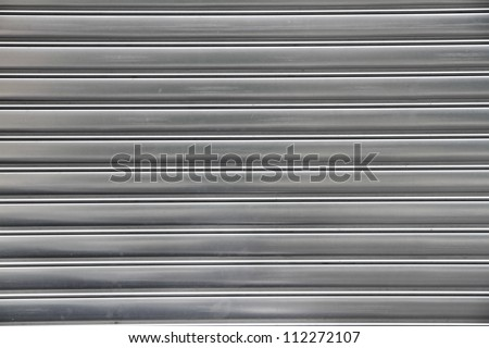 metal security roller door background - stock photo