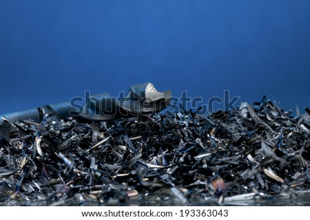 Metal shavings with a drill - stock photo