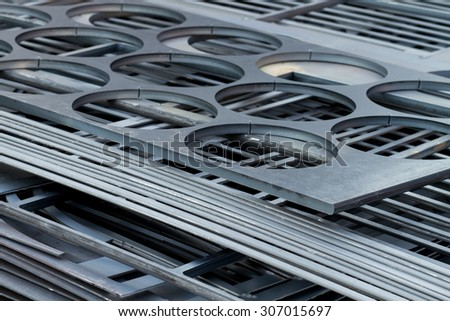 metal sheets cutted by laser - stock photo