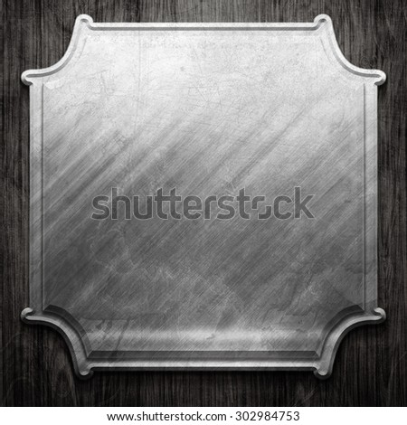 Metal signboard on old wooden background - stock photo