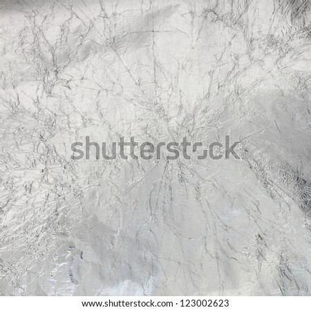 Metal silver wrinkled surface - stock photo