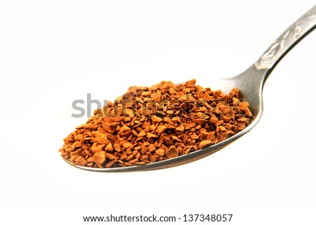 metal spoon of instant coffee granules on a white background. - stock photo