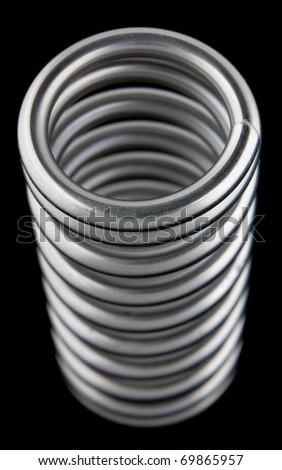 Metal spring on white background - stock photo