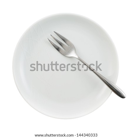 Metal stainless steel fork in a ceramic white plate isolated over white background, view above - stock photo