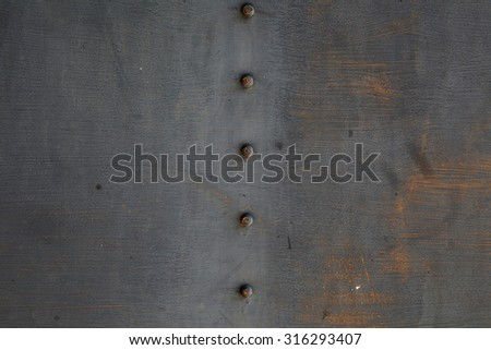 Metal steam punk background. Grunge background metal plate with screws - stock photo