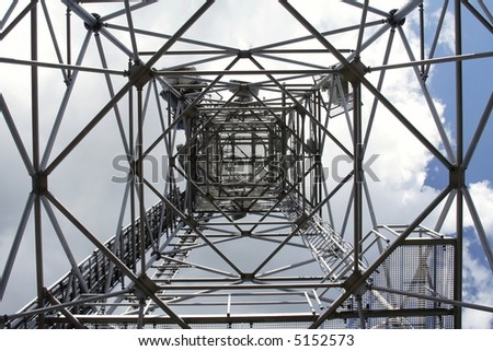 metal structure  of antenna mast under sky with clouds - stock photo