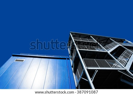 metal structure with a ladder on a background of blue sky - stock photo