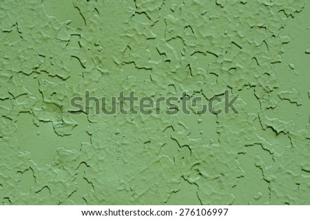 Metal surface painted green, texture. Peeling paint, many old layers.  - stock photo