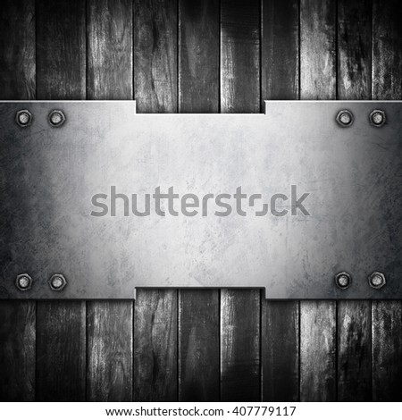 metal template on old wood plank background - stock photo