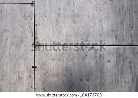 Metal texture - Grungy brushed brass shiny metal plates with screws. - stock photo