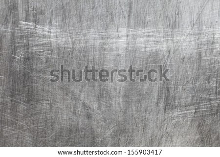 metal texture with scratched abstract pattern closeup - stock photo