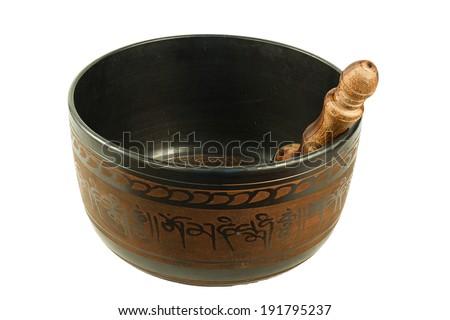 metal Tibetan singing bowl isolated on white background - stock photo