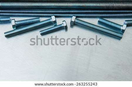 Metal tools. Metal style. Metal hairpins and bolts on the scratched metal background. - stock photo