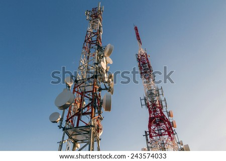Metal tower or turret telecommunications satellite dishes reception and emission - stock photo