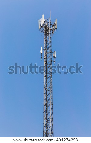 Metal tower with antennas for mobile cell phone telecommunications against blue sky  - stock photo