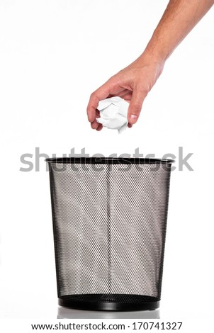 Metal trash bin from paper and hand  - stock photo
