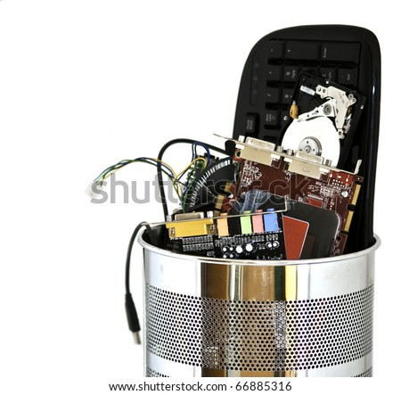 Metal trash can containing computer waste isolated on white background - stock photo