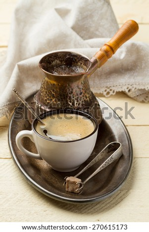 Metal tray with fresh coffee for breakfast on white wooden table - stock photo