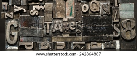 Metal Type Printing Press Typeset Obsolete Typography Text Letters Taxes - stock photo