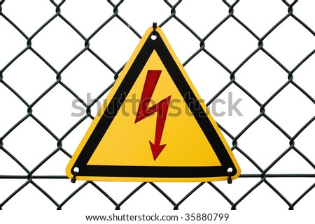 "Metal warning sign ""High voltage"" tied to a fence. Isolated on white. - stock photo"