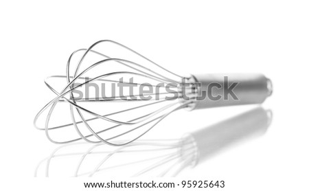 Metal whisk for whipping eggs isolated on white - stock photo