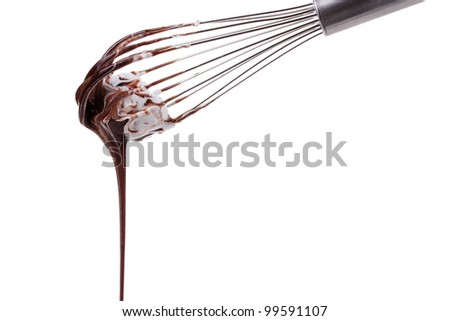 Metal whisk for whipping eggs with chocolate cream isolated on white - stock photo