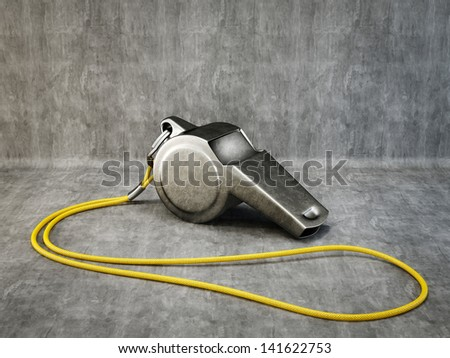 metal whistle isolated on a grey background - stock photo
