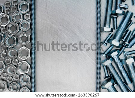 Metal working tools. Frame metal style. Hairpin and other fixing elements on the scratched metal background. - stock photo