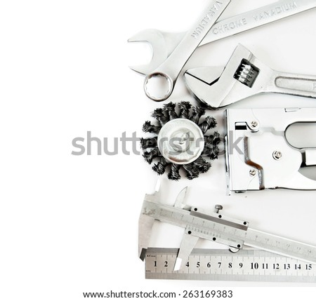 Metal working tools. Metalwork. Ruler, caliper and others tools on white background. - stock photo